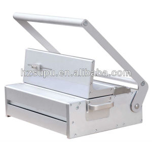 Manual punching machine with interchangeable dies