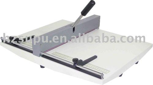 دليل آلة التجعيد ورقة على طاولة-- الأعلى