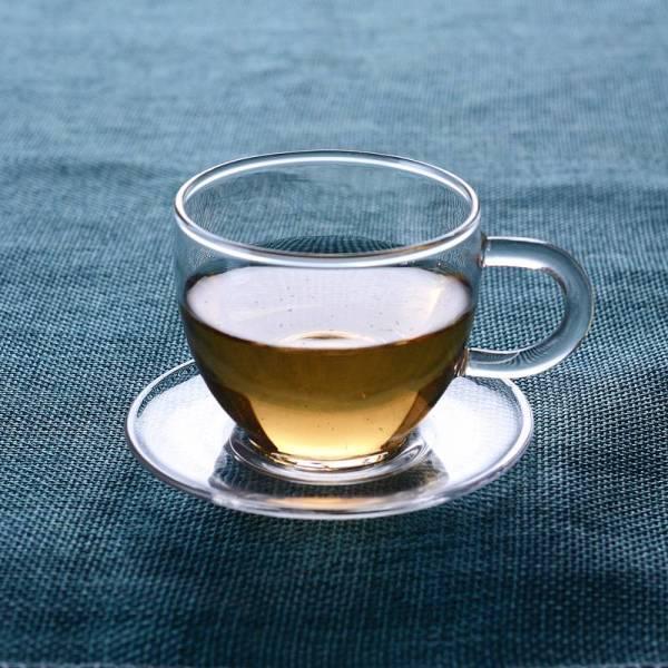 Tasses à thé en verre à paroi simple en porcelaine avec poignée