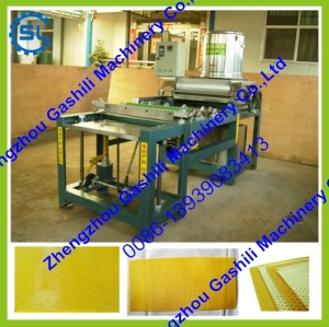 Newly developed automatic beewax foundation sheet machine