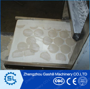 New Design Simulated Hand Chinese Dumpling Skin Making Machine JiaoZi Skin Machine 0086-13643842763