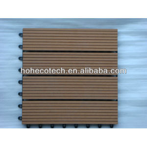 Interlocking wood plastic composite deck tiles