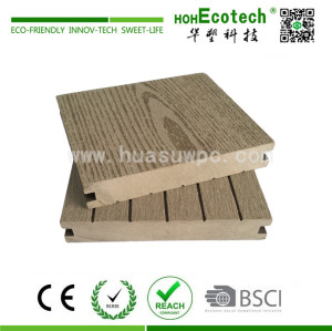 Decorative wood plastic composite decking material