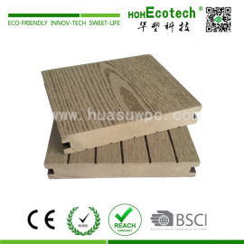 Decorative wood plastic composite decking material