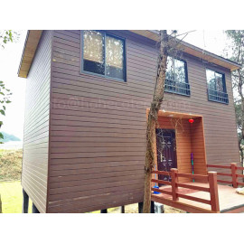 Wooden house with wpc composite wall cladding/decking/railing