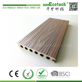 Wood plastic composite decking with a protection layer surface