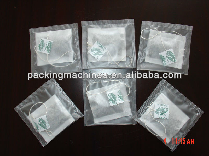 dxdk-- 100 nwd التلقائي آلة التعبئة كيس شاي مع الخيط والعلامة مغلف