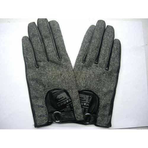 FABRIC WITH BLACK LEATHER GLOVES