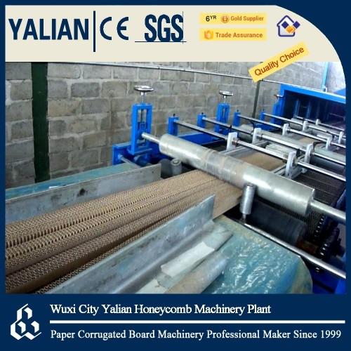 Vertical corrugated paper panel machine