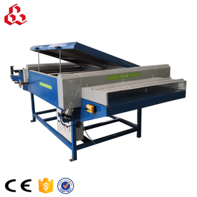 Honeycomb core expanding machine with cutter