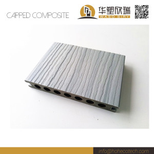 Low maintenance capped wood plastic landscaping decking board
