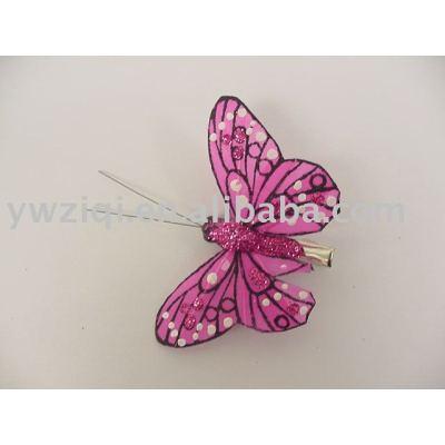 Fine glitter powder spraying on craft butterfly