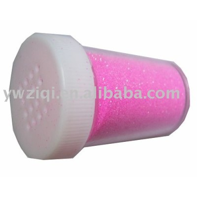 Rainbow color fine glitter powder in the bottle