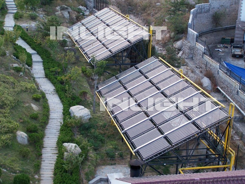 Double side evacuated tube solar collector