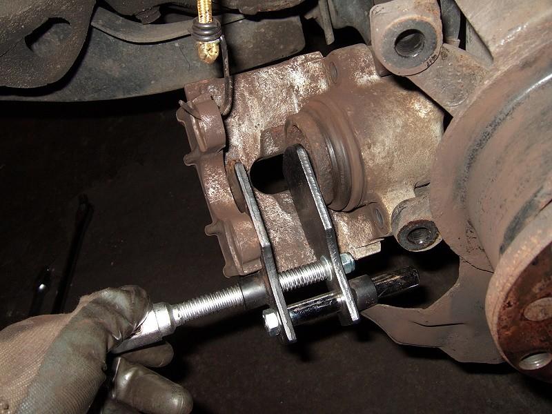 if you are piston brake,use brake piston tools to reset