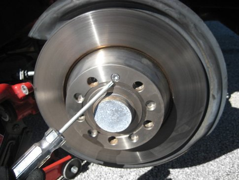 Special torx head bits or hex keys may be required to remove bolts which secure brake rotors in place.