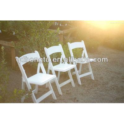hotel white folding chair