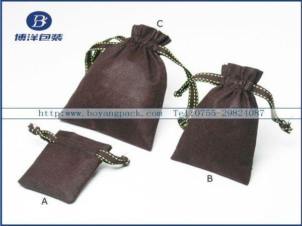 white non-woven jewelry bag drawstrings