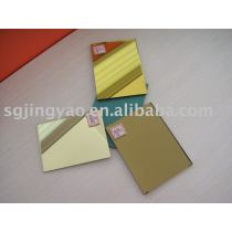 golden mirror with green paint