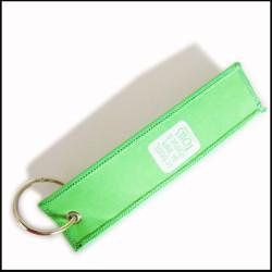 白色提花图案绿色锁边钥匙挂饰