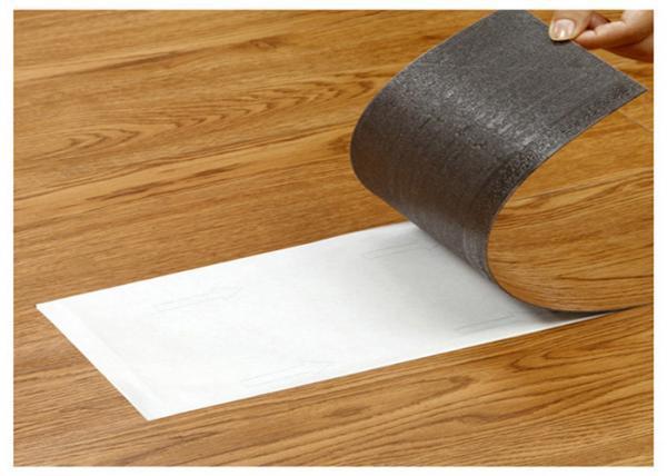 Self-adhesive vinyl tile
