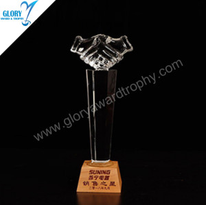 Superior quality handshake shaped crystal trophy with wooden base