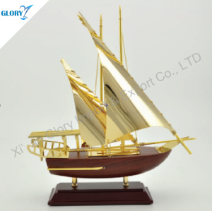 Beautiful Golden Model Sailboat Sails