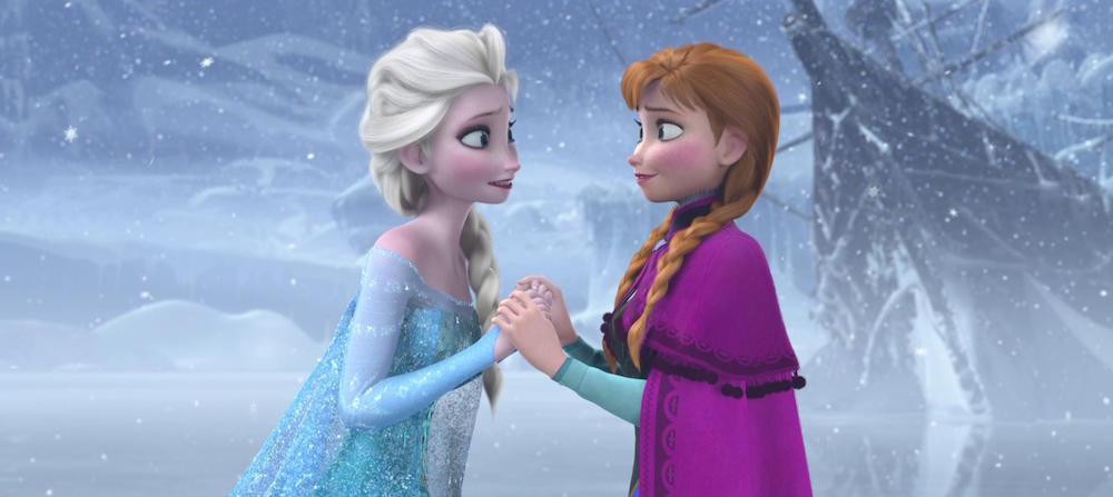 2Anna-and-Elsa-from-Frozen-hold-hands-and-look-at-each-other