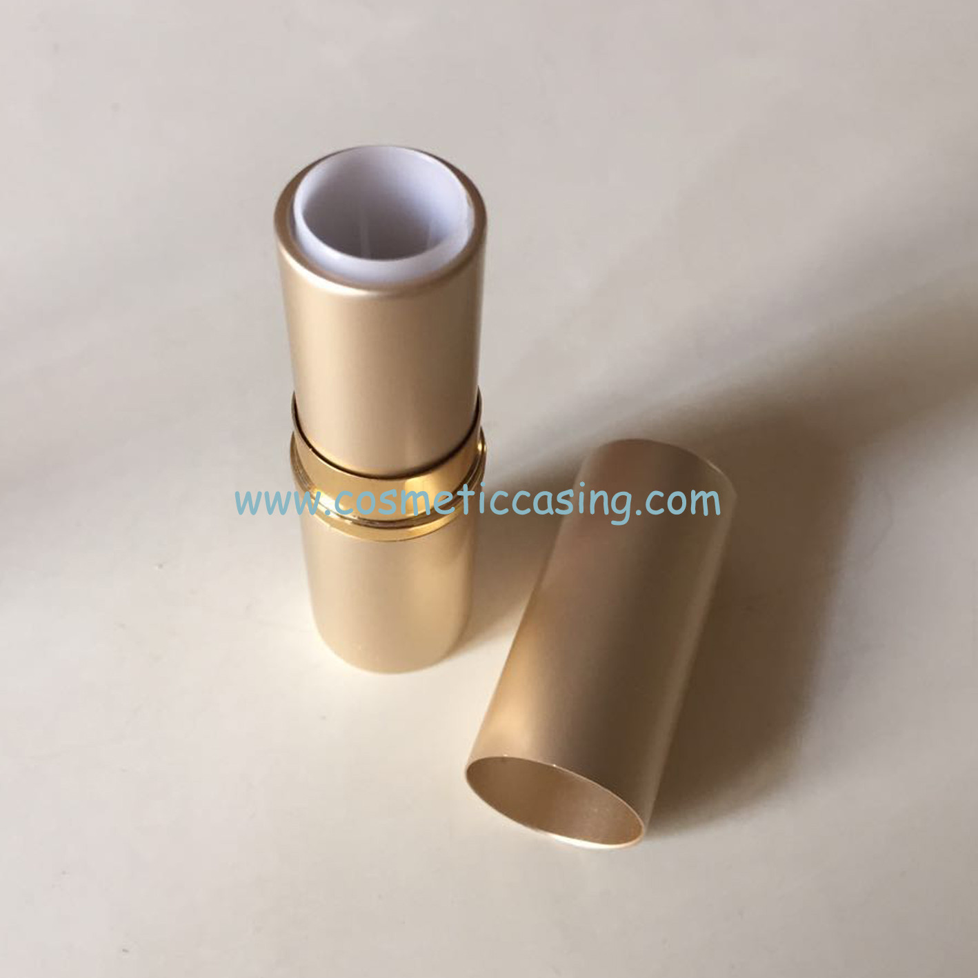 golden lipstick tube, lipstick container, lipstick case
