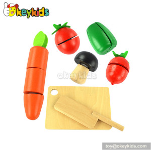 Pretend play children cutting wooden toy vegetable W10B169