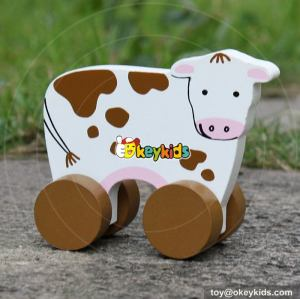Best design baby cartoon cow toys wooden toy vehicles W04A322