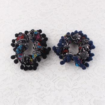 Winter boho ethnic hair scrunchie with pom pom
