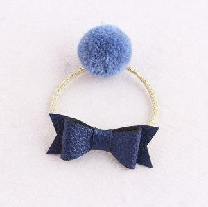 Children blue pom pom ponytail holder with leather bow