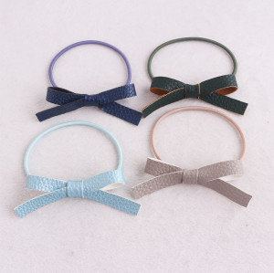 Girls PU leather bowknot ponytail holder hair rope tie in China