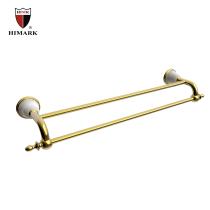 Wall mounted dual long towel rack in brass
