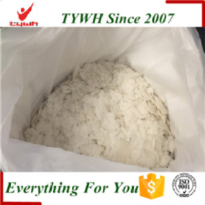 Using caustic soda NaOH Sodium hydroxide