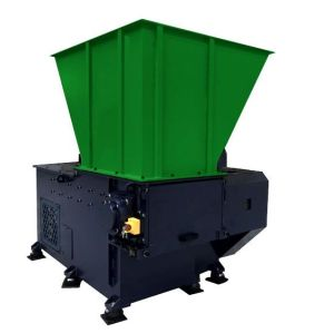 Industrial single shaft shredder machine for recycling applications.