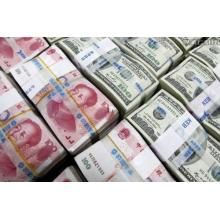 China Lets Yuan Tumble Past 7 Per Dollar as Trade War Escalates