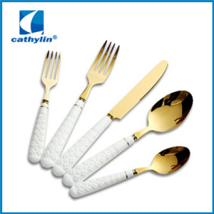 Ceramic handle golden flatware set