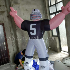 Inflatable rugby player