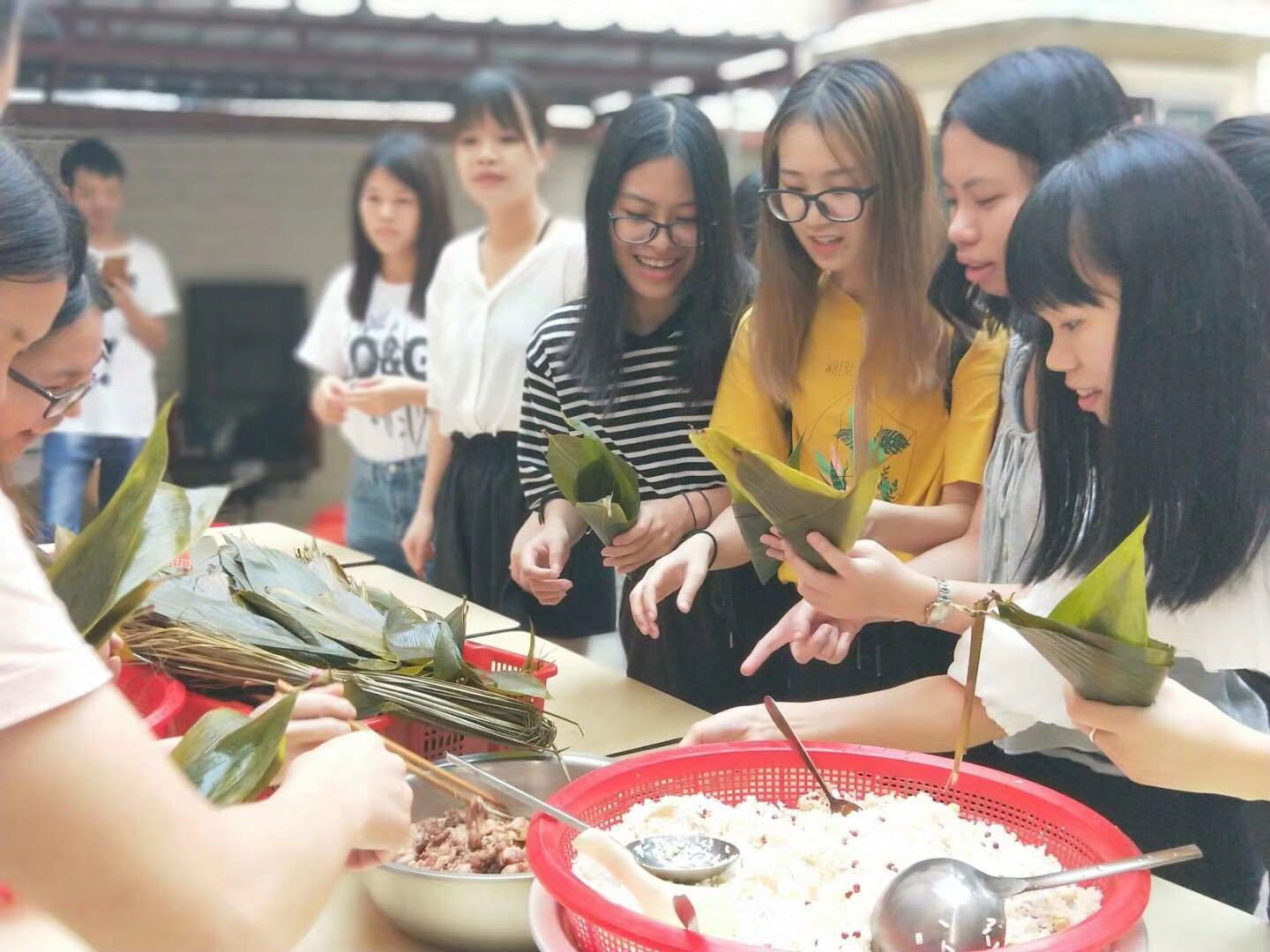 Hucai Sportswear Staff Making Rice Dumplings