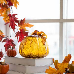 Transparent amber decorative pumpkin ornament with stem