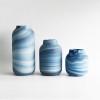 Sleek Style Understated Swirl Pattern Draws Blue Glass Vase
