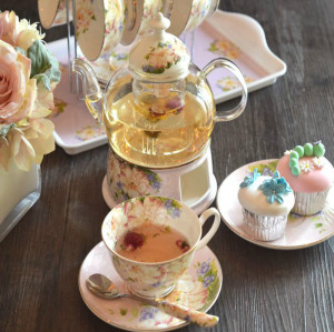 Bone china tea cups and glass pot