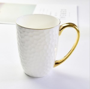 Embossed gold ceramic cup