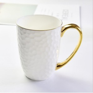 Embossed gold ceramic cup