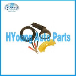 Vehicle a/c service tools, hook up to the car battery with glasses