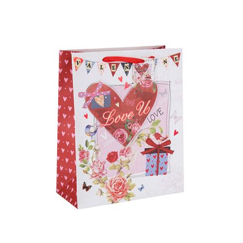 Bolsa de papel de regalo de San Valentín estilo corazón con logotipo personalizado con etiqueta colgante con diferentes tamaños con 3 diseños surtidos en embalaje de llave