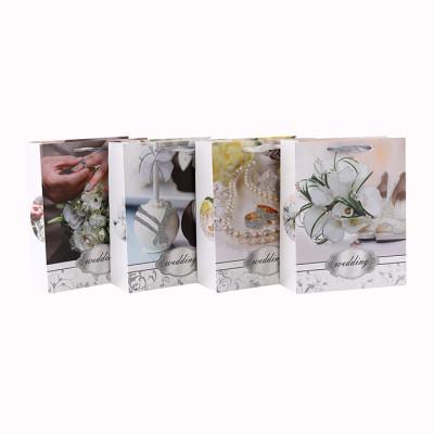 Weiße Pappblumen-romantische Art-Funkeln-Geschenk-Papiertüte mit 4 Entwürfen sortierte in der Tongle-Verpackung