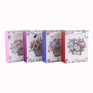 白の段ボールの花のデザインリボンの手紙のギフトバッグ4つのデザインとトングパッキングで盛り合わせ